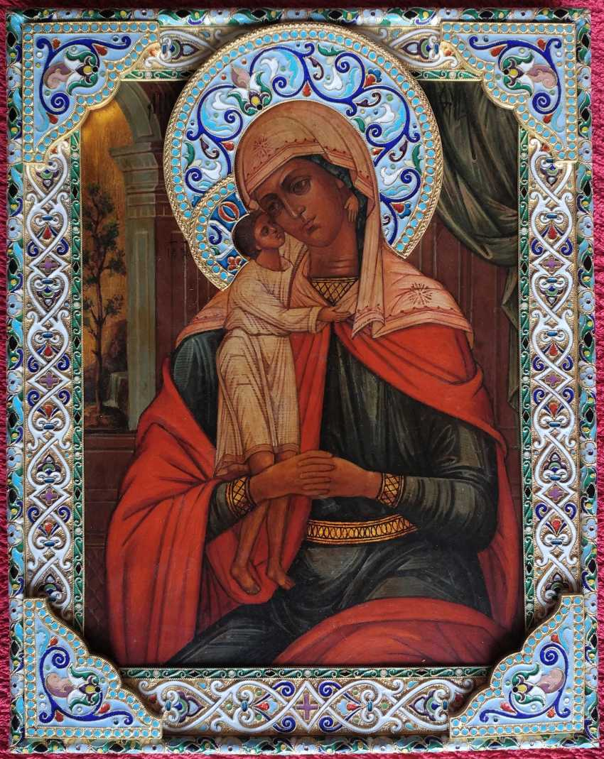 The icon of the Mother of God in a silver frame - photo 1