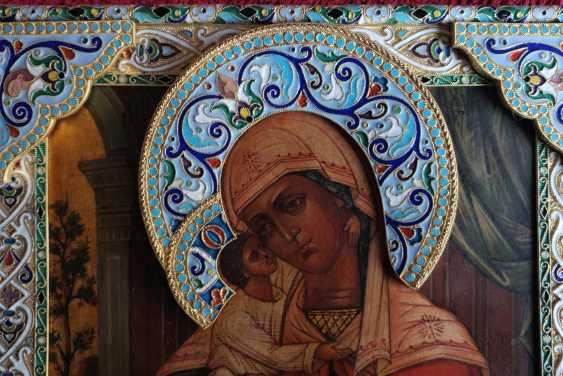 The icon of the Mother of God in a silver frame - photo 2