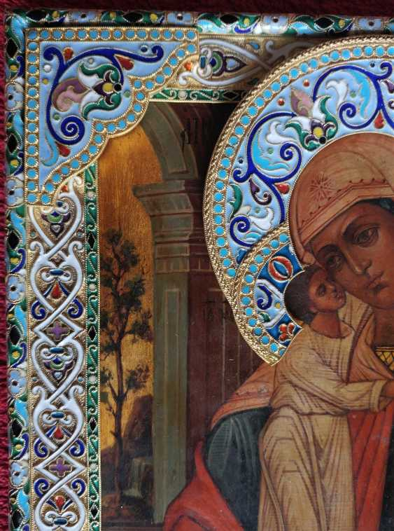 The icon of the Mother of God in a silver frame - photo 3