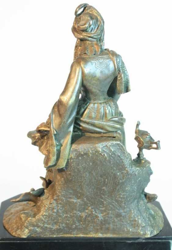 A clock with a bronze figure - photo 3