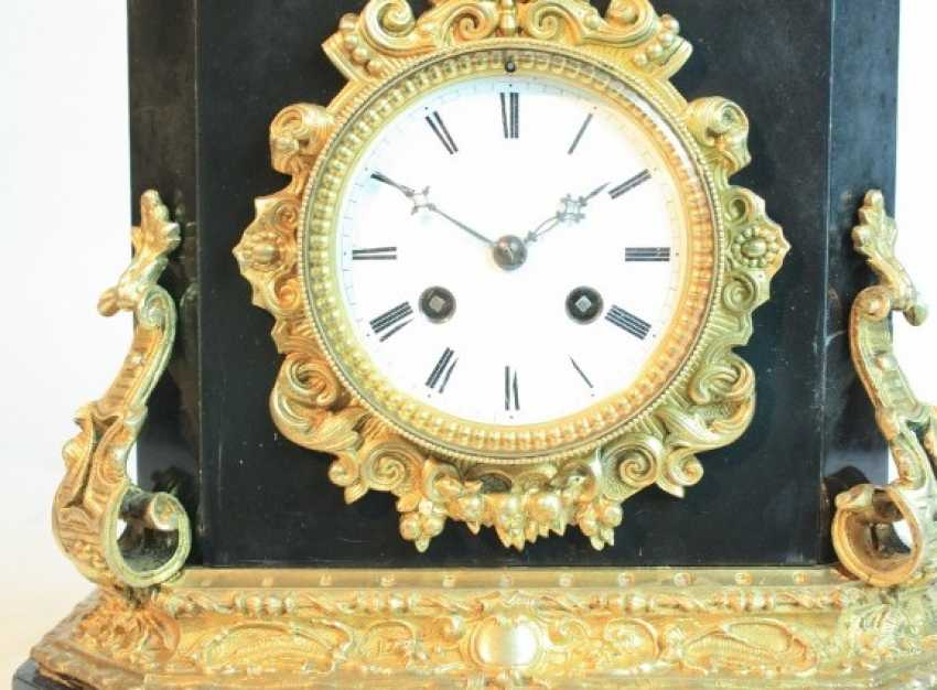 A clock with a bronze figure - photo 4