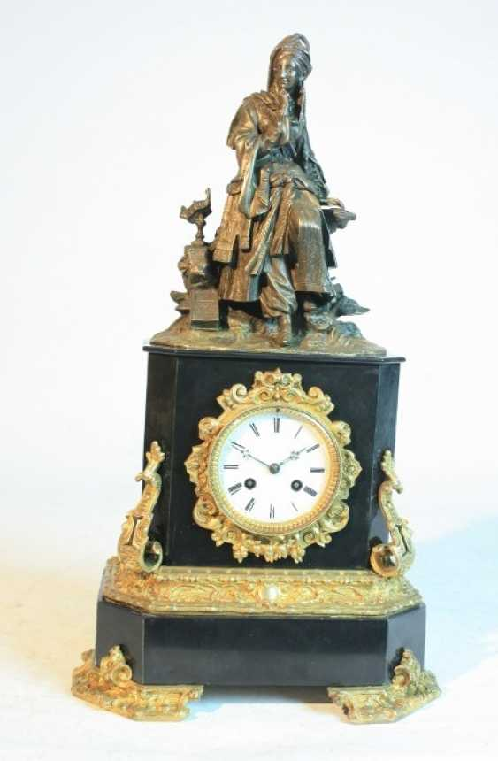 A clock with a bronze figure - photo 1
