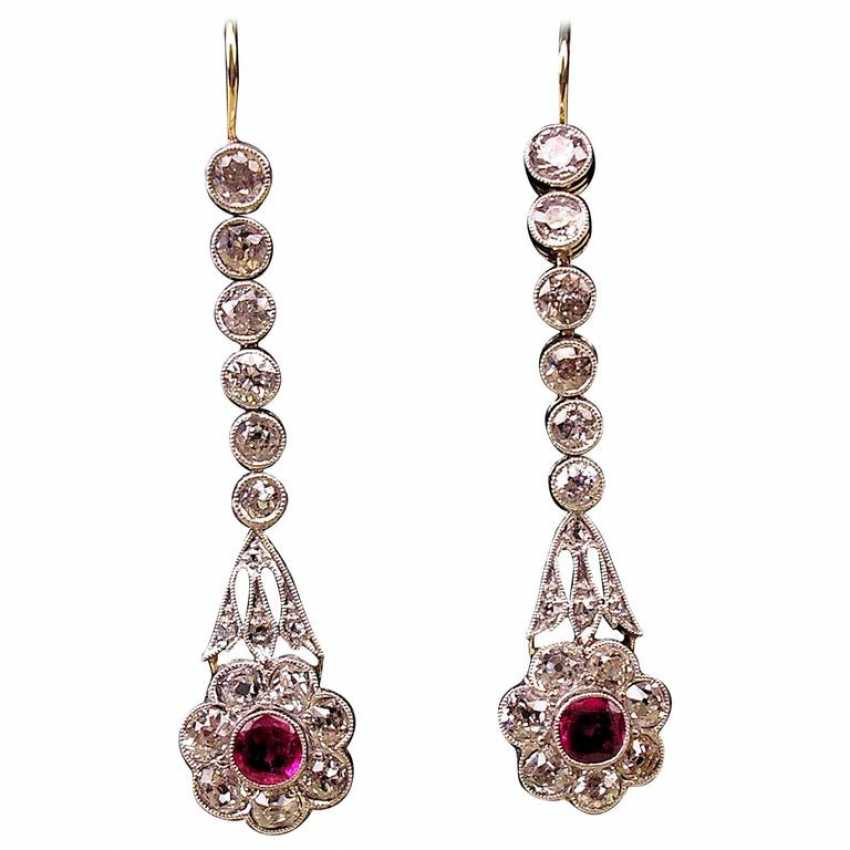 ART NOUVEAU DROP EARRINGS WITH NUMEROUS BRILLIANT-CUT DIAMONDS AND WITH A RUBY OCCUPIED - photo 1