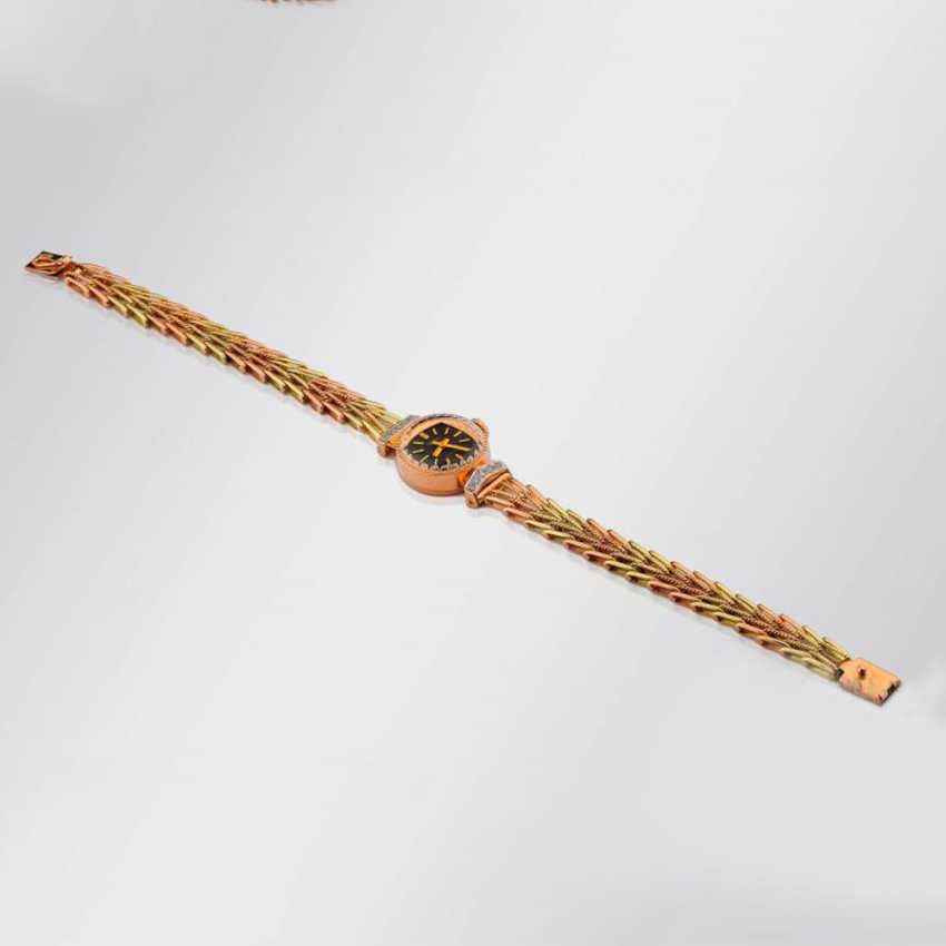 Gold wrist watch with diamonds - photo 1