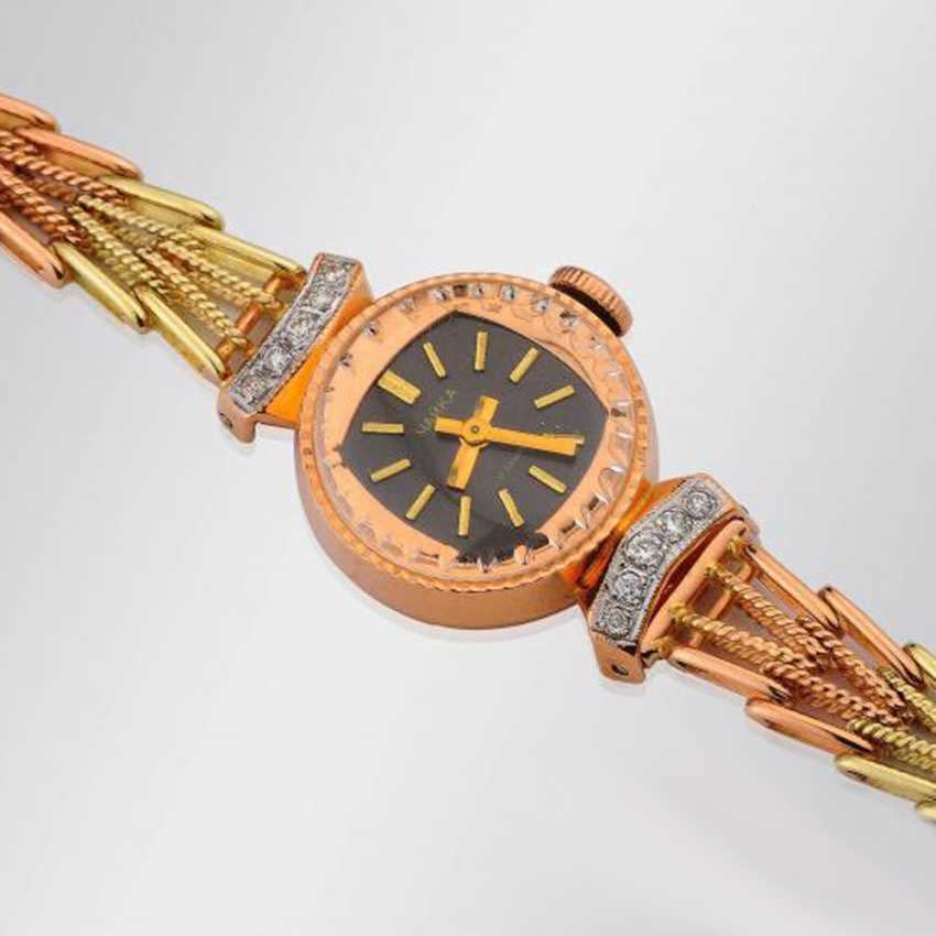 Gold wrist watch with diamonds - photo 2