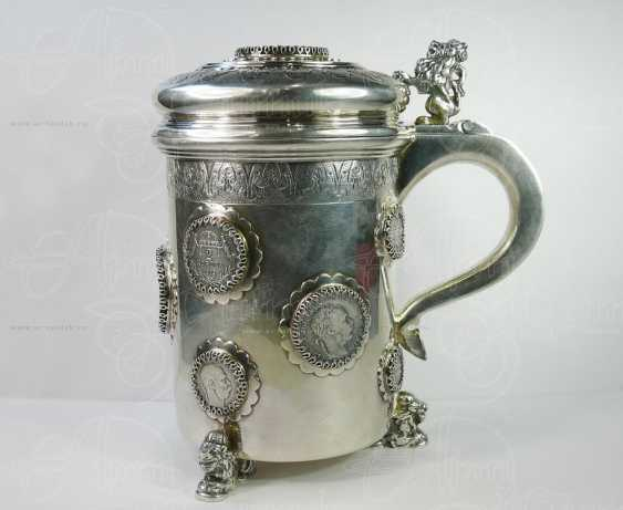 Mug of beer with coins - photo 1