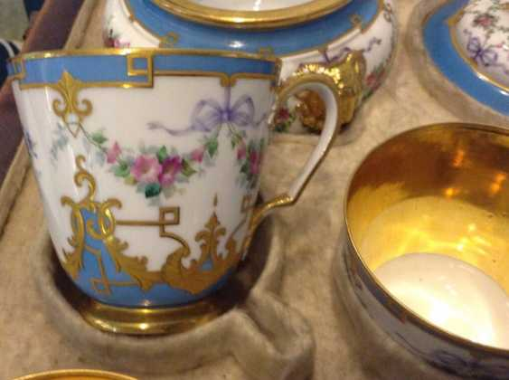 "The tea and coffee service in the style of ""neo-Rococo"" C ""Board blue flowers, and musical instruments for twelve people"" in the native coffer ( box) with the Tula lock. Russia, Saint-Petersburg , Imperial Porcelain Factory, 1860-s - photo 1"