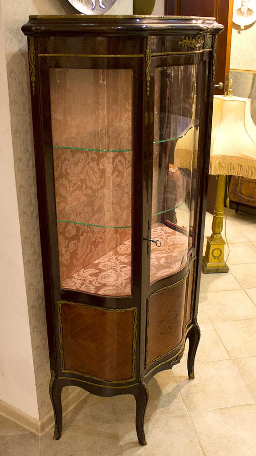 Antique showcase with a stacked figure and overlays - photo 2