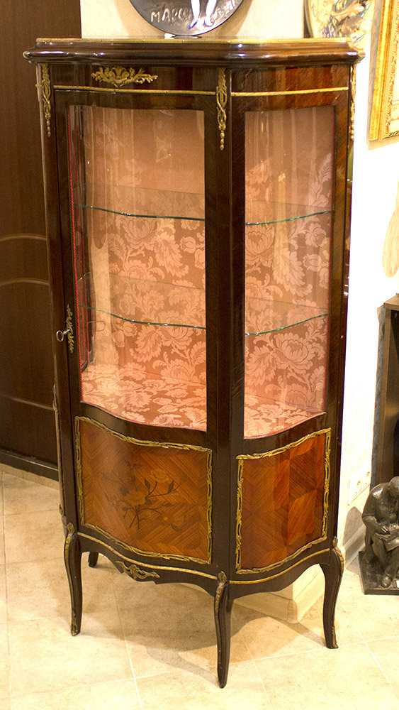 Antique showcase with a stacked figure and overlays - photo 1