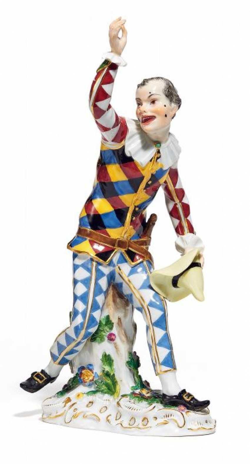 HARLEQUIN WITH HAT FROM THE 'COMMEDIA DELL'ARTE'. Meissen. Prior to 1924. Model By J. J. Kaendler