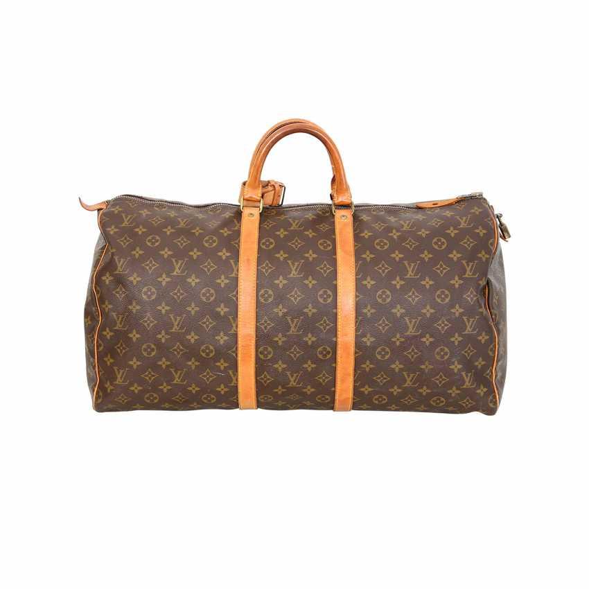 7b4d60afd053 Lot 14. LOUIS VUITTON VINTAGE travel bag