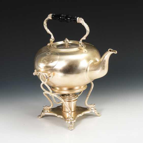 Teekanne auf Rechaud. - Foto 1