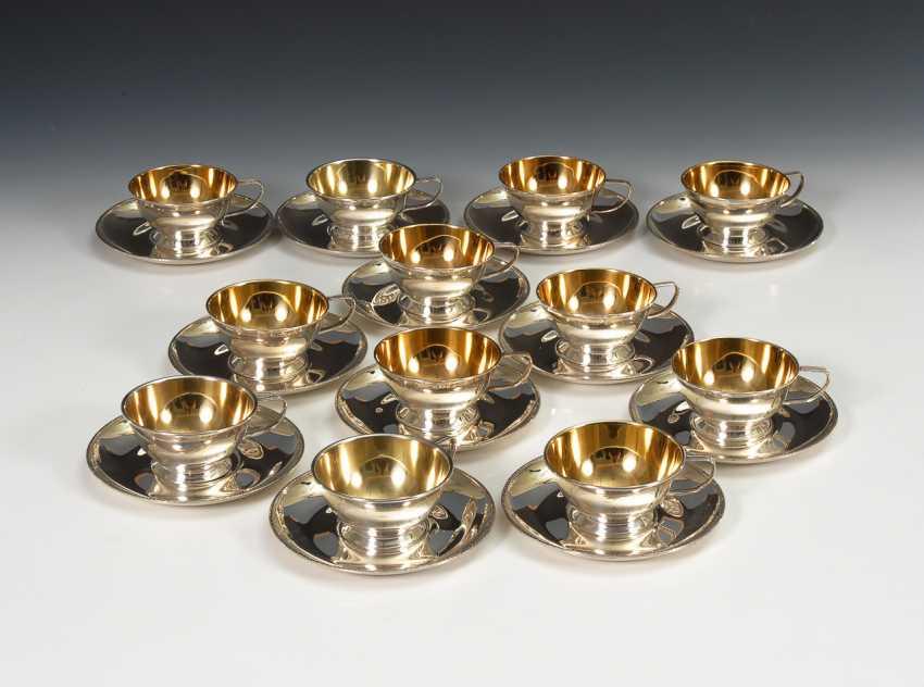 12 silberne Tassen mit Untertassen. - Foto 1