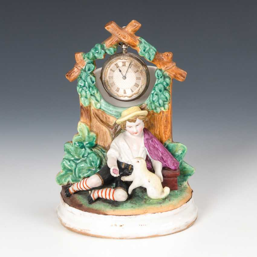 Porzellan-Uhrständer mit silberner Taschenuhr. - Foto 1