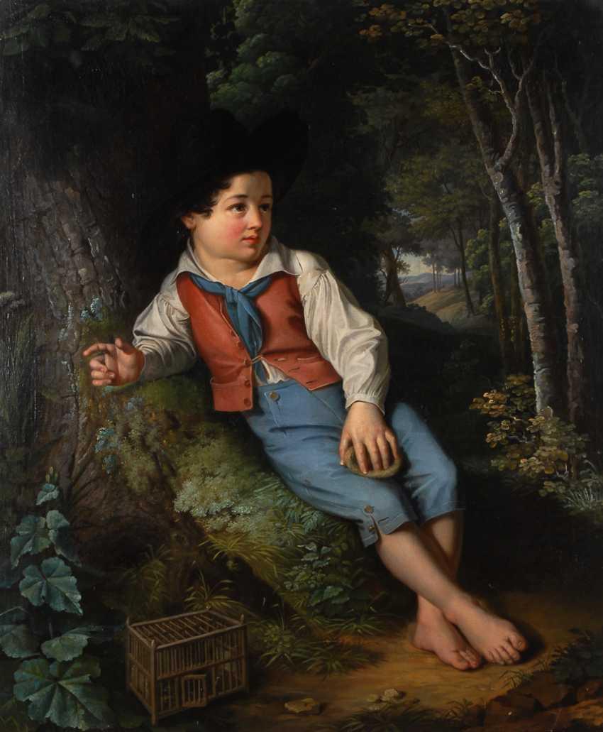 Kinderbildnis mit Junge und Vogelkäfig im Wald. - Foto 1