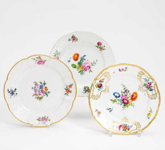Three plates with a Relief and floral decoration - photo 1