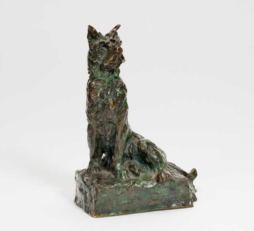 Figur eines sitzenden Hundes - Foto 1
