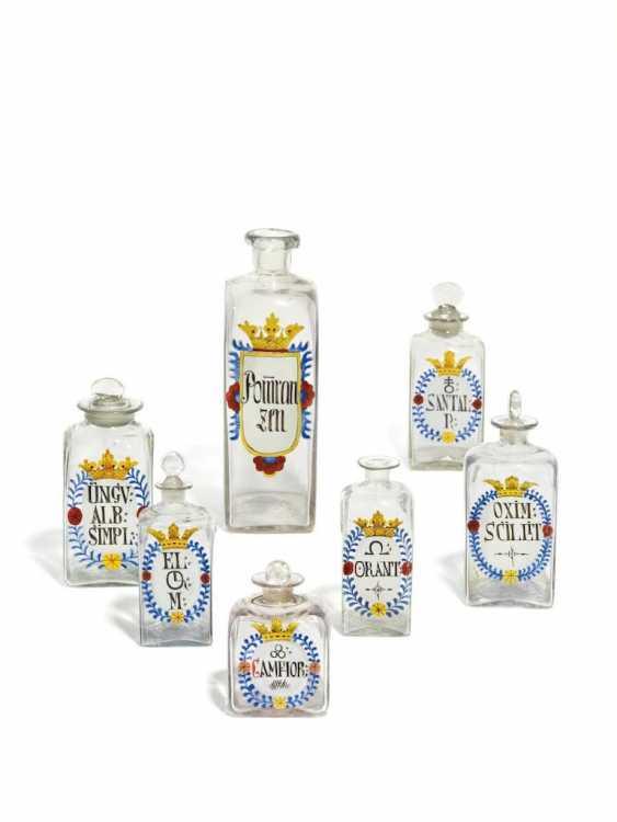 Sieben Apothekenflaschen - Foto 1