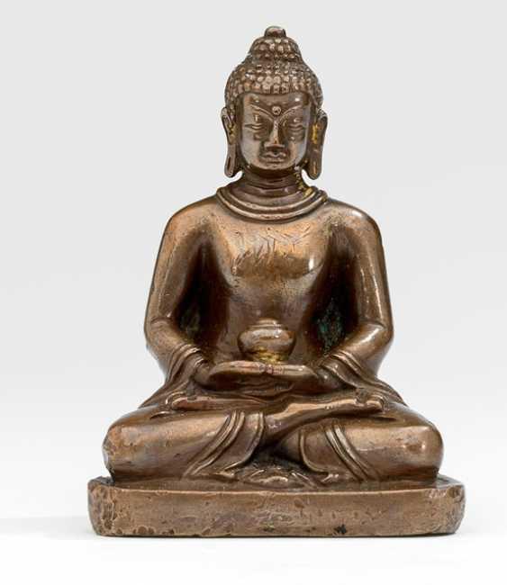 Bronze of Buddha Shakyamuni with a alms bowl in the meditation seat - photo 1