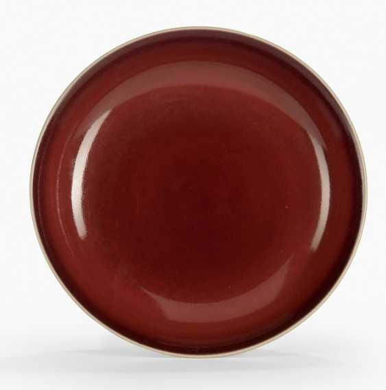 A fine copper red glazed porcelain plate - photo 1