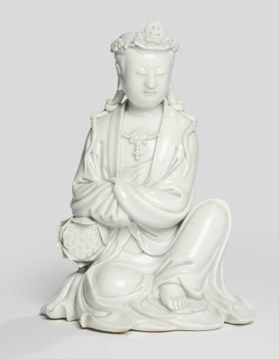 Dehua figure of Guanyin, shown seated with a Lotus - photo 1