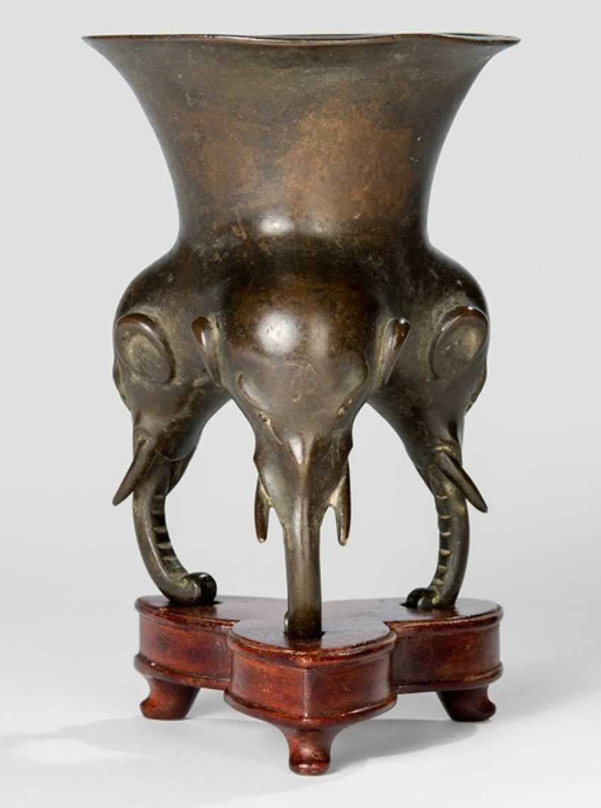 Incense burner made of Bronze with three elephant head legs on a wooden stand - photo 1
