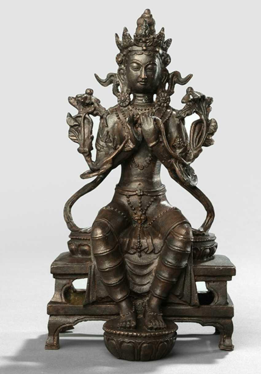 A Bronze sculpture of a Maitreya sitting on a throne - photo 1