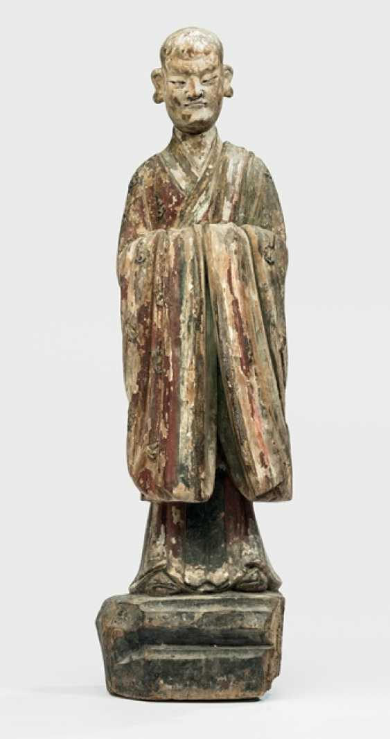 Colored figure of a standing monk wood-encased and partly with Gold decorated - photo 1