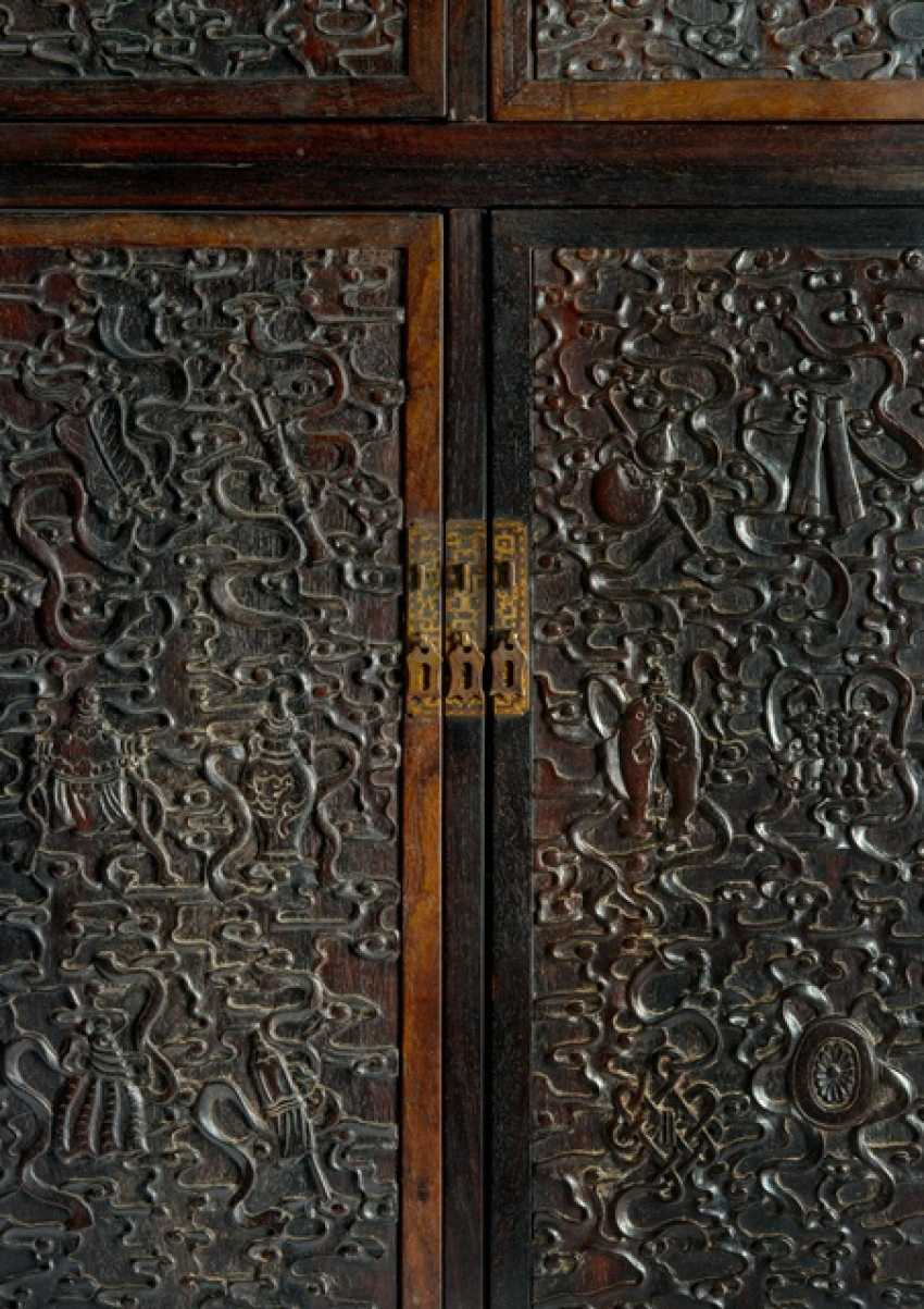 Fine Cabinet made of hard wood with Buddhist emblems and clouds pattern - photo 2