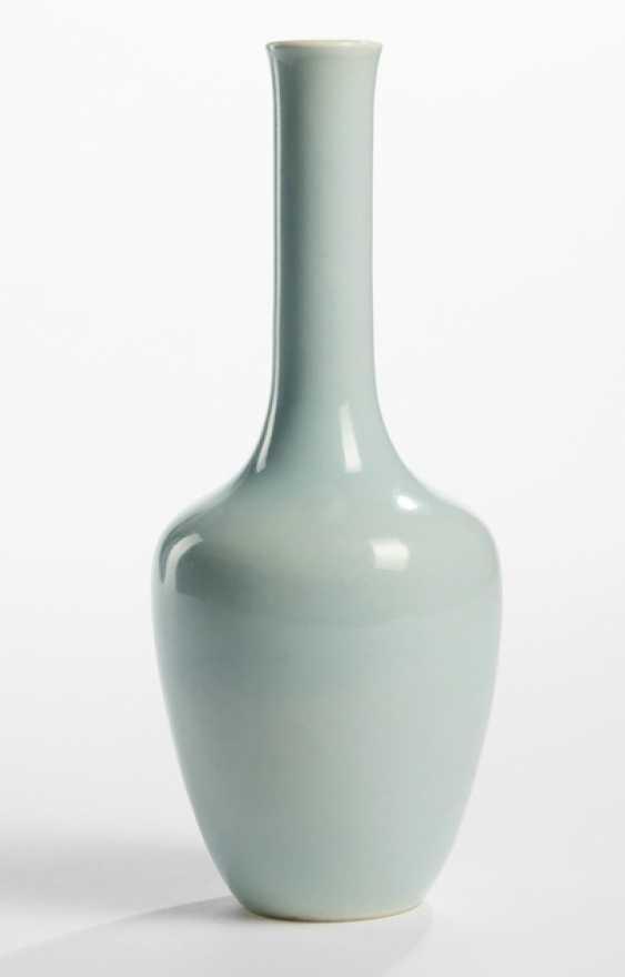 Light blue glazed bottle vase made of porcelain - photo 1