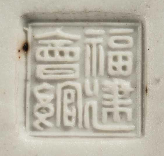 Under glaze blue decorated porcelain figure of seated Budai - photo 3