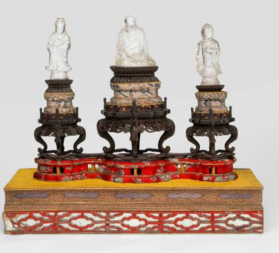 Group of three crystal figures, including Buddha and Guanyin on a wooden base - photo 1