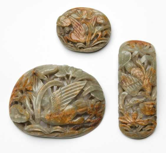 Three belt buckles made of pale green Jade with russet inclusions - photo 1