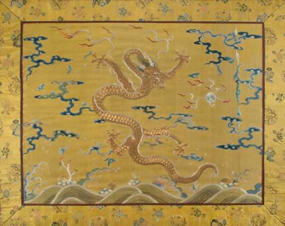 Yellow basis silk embroidery of a dragon chasing the flaming pearl - photo 1