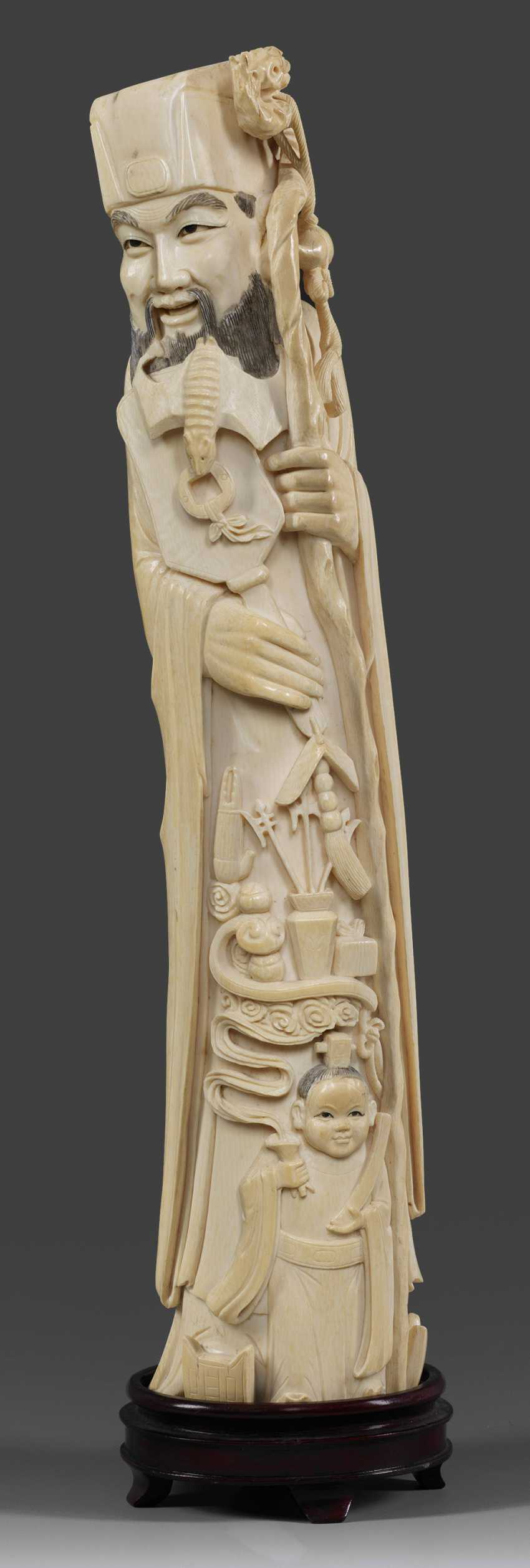 Large ivory figure of a scholar with a dragon cane - photo 1