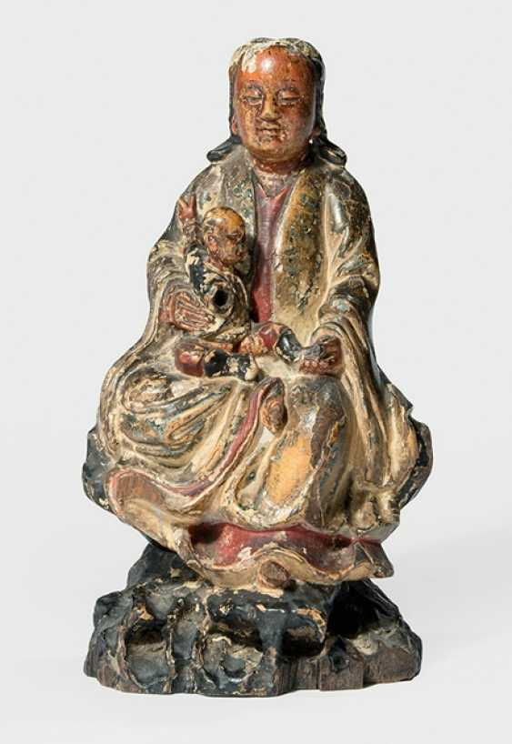 Polychrome ducted wood figure of Guanyin on a rock with a boy - photo 1