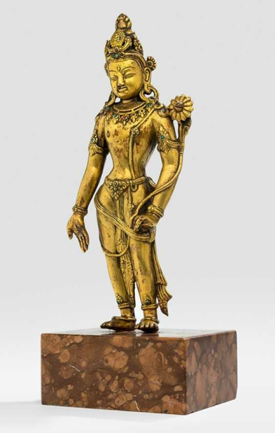 Fire-gilt Bronze of Padmapani on a stone plinth - photo 1