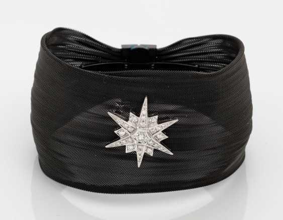 Extravagant bracelet with diamond star - photo 1