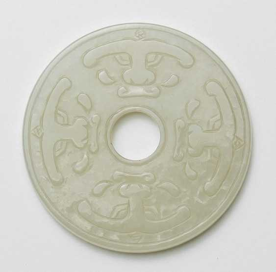 Bi-disk made of Jade in the archaic style - photo 1