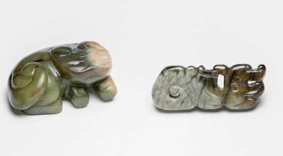 Jade pendant in the Form of a stylized dragon, and a carving of a horned animal - photo 1