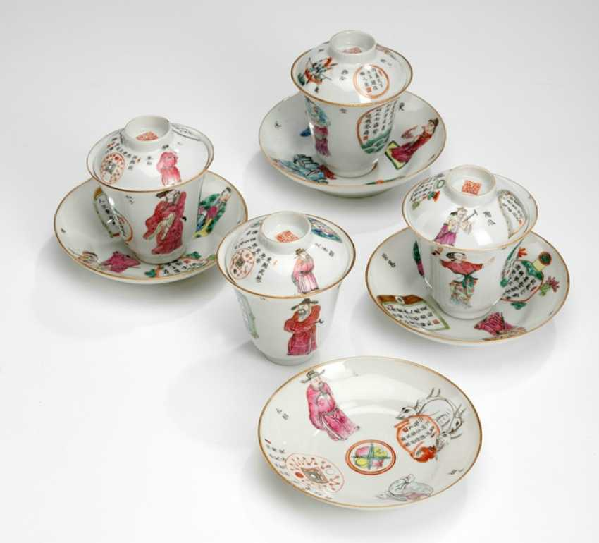 Four cups with lids and saucers made of porcelain with poems and figures - photo 1
