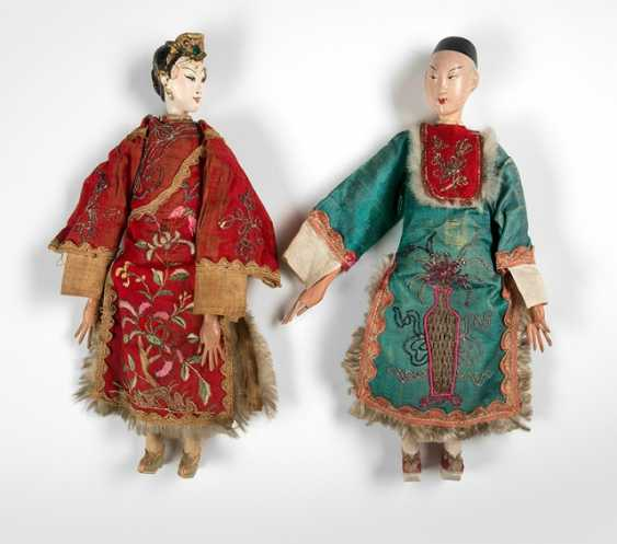 A doll dressed couple of the traditional puppet theatre in Silk - photo 1