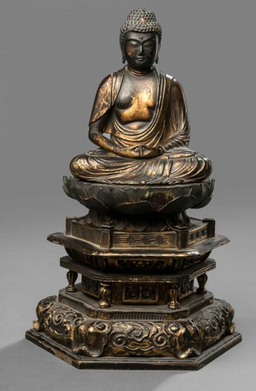 Sculpture of the Buddha Amida made of wood with black and gold colored paint version - photo 1
