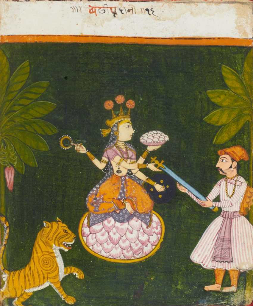 The goddess Durga receives the sword to fight the demon - photo 1