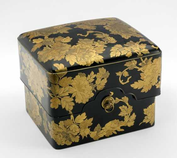 Cover jar with fine gold paint decoration of flowering peonies on a black background - photo 1