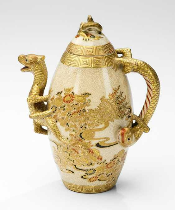 Small Satsuma teapot with floral decoration, the spout and handle in Form of dragon - photo 1
