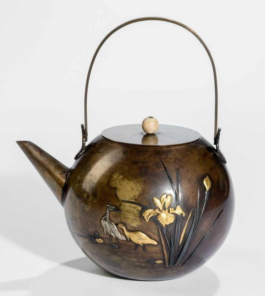 Teapot made of brass with decoration of herons and irises, Details in Gold and silver - photo 1