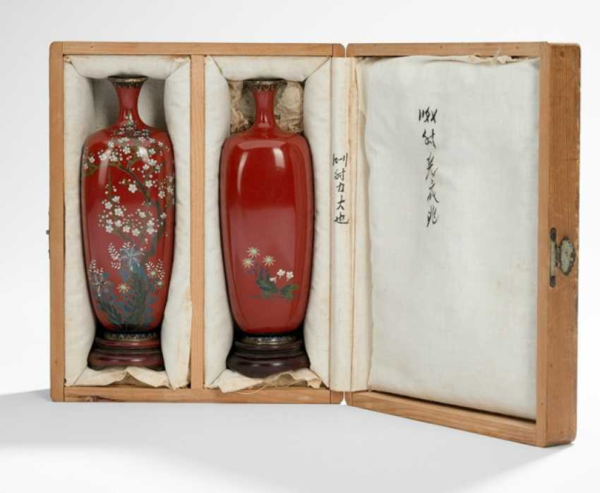 Pair of Cloisonné vases with decoration of plum blossoms and lilies on rust red background - photo 1