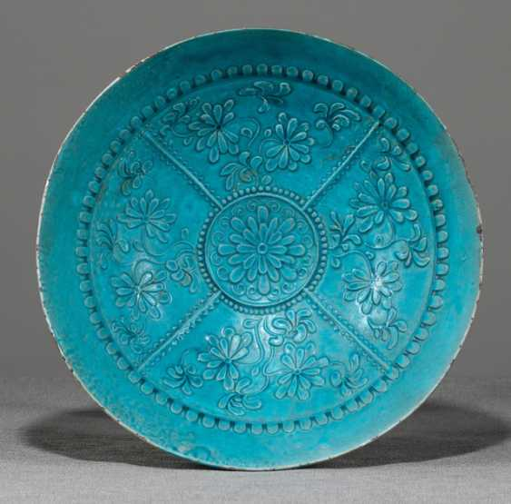 Turquoise glazed bowl made of ceramic with sculpted decor of flowers - photo 1