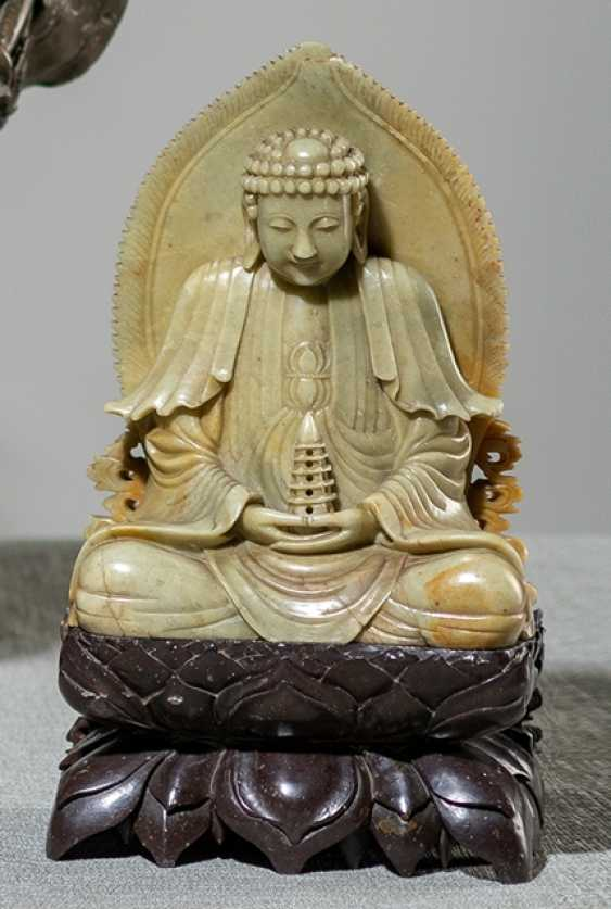 Soapstone carving of Buddha on a pagoda holding - photo 1